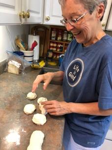 Joanne making rolls